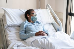 Black-woman-in-hospital-bed